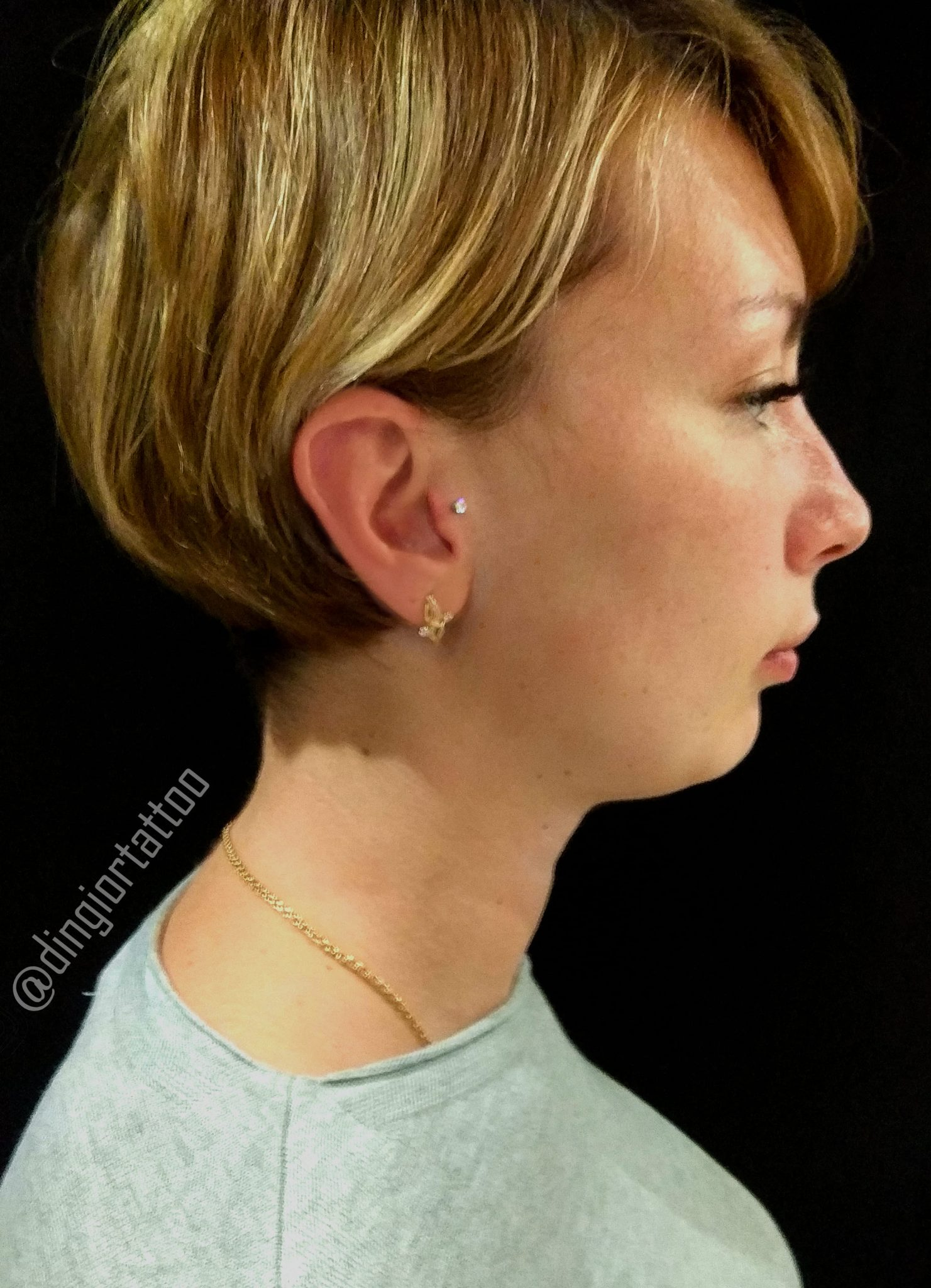 piercing tragus and lobe